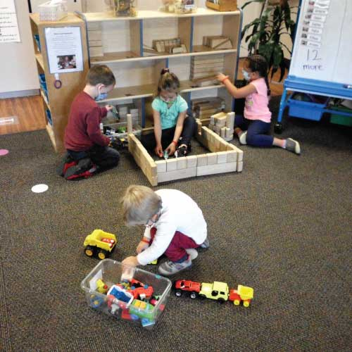 discovery-school-kids-playing-with-toys-at-school
