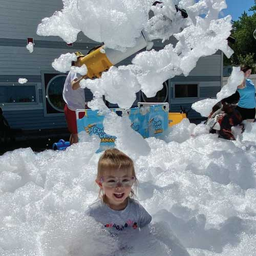 little-girl-playing-in-foam-pit-image-discovery-school